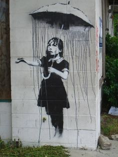 Bansky art:: Rain Girl, the soul surviving artwork of Bansky in New Orleans. She is protected behind plexiglass.