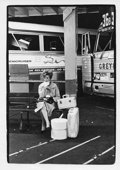 Woman with luggage sitting on bench at bus station. Bus Station, Train Station, Bus City, Vintage Luggage, Vintage Suitcases, Freedom Riders, Bus Terminal, Bus Travel, Bus Stop