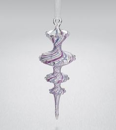 """""""Pirouette"""" Art Glass Ornament Created by James Byrnes Trails of violet and white wrap the graceful curves of this blown glass ornament in a delightful spiral. An Artful Home exclusive."""