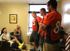 Broncos players spending time with patients who were injured in the Aurora shootings.
