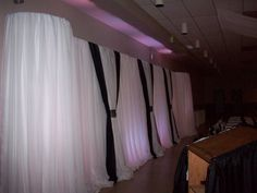 Backlit pipe and drape wall Courtesy of Par-Tee Rental