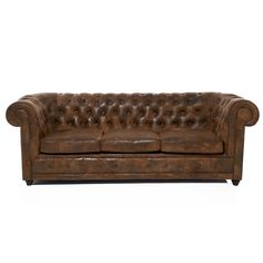 Masculine brown leather tufted couch. Perfect for the gentlemen study or the sophisticated man cave.