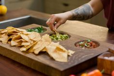 Handmade dip board with three carved out bowls. The bowls can be used to hold oil andbalsamic, soy sauce, hummus,nuts, fruit, vegetables... the list goes on a