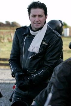 SCARF SCARF. THE SCARF. AND HAIR IN THE WIND ALL WRAPPED UP IN A HOT LEATHER