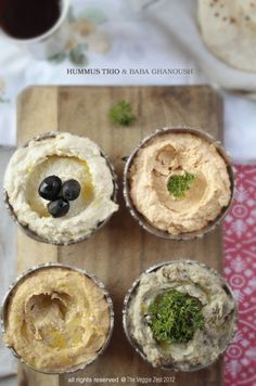 hummus trio & baba ghanoush. perfect appetizer spread.