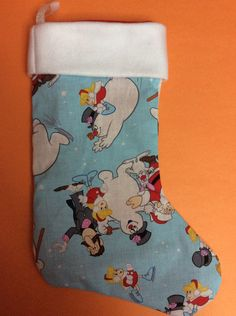 A personal favorite from my Etsy shop https://www.etsy.com/listing/253031400/handmade-christmas-stocking-frosty-the