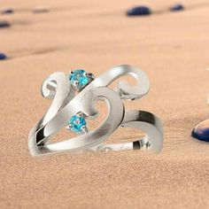 Beautiful ribbons of silver flowing in the wind sparkle with the blue colors of the sea in this unique ring. Made by Joryel Vera, it looks great and feels smoo