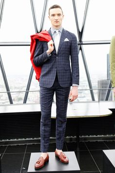 Rock a navy plaid sportcoat with dark blue plaid suit pants for a sharp, fashionable look. If you don't want to go all out formal, choose a pair of oxblood leather tassel loafers.  Shop this look for $401:  http://lookastic.com/men/looks/blazer-and-dress-pants-and-dress-shirt-and-tie-and-pocket-square-and-tassel-loafers/865  — Navy Plaid Blazer  — Navy Plaid Dress Pants  — Grey Dress Shirt  — White Tie  — White Pocket Square  — Burgundy Leather Tassel Loafers