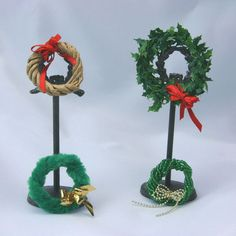 Simple miniature wreaths made from wired trim can be decorated easily with bows or other scale items.