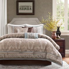 Refresh your master suite or guest room with this lovely comforter set, showcasing a damask motif for eye-catching appeal.  Product:...