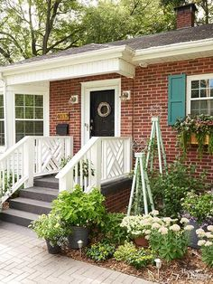 Get inspiration to amp up your home's curb appeal from this done in a weekend DIY front porch remodel. Painted shutters, added flower boxes, a DIY wreath and colorful decor added a welcoming feel to the front of this charming house. Diy Exterior, Exterior Paint Colors, Exterior Shutters, Exterior Makeover, Exterior Design, House With Porch, House Front, Front Porch Remodel, Front Porches