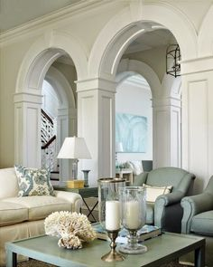 Inside, an arched colonnade dressed in gleaming white woodwork separates the family room from the living room. Extensive interior millwork is a hallmark of British Colonial style. Home Living Room, Living Room Decor, Living Spaces, Small Living, Beautiful Interiors, Beautiful Homes, Piece A Vivre, My Dream Home, Great Rooms