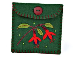 Green felt coin purse with fuchsia flowers and leaves in hand applique and embroidery, contrasting lining, blanket stitched edges and button