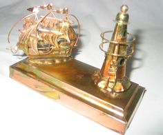Berkeley Designs vintage music box Schooner and Lighthouse, cute for home or office for Dad. $14.99