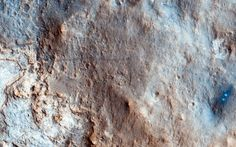 The High Resolution Imaging Science Experiment (HiRISE) on board the Mars Reconnaissance Orbiter snapped a color, high-resolution image of Curiosity's landing site in an image released January 30, 2013.  The two white spots on the right side of the photograph are where the sky crane's rockets blew away surface materials as it delivered the red planet's latest rover.  HiRISE also picked up Curiosity's track marks (darker double lines) leading away from the landing site.