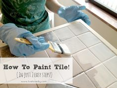 How to easily paint outdated tile in only 2 steps! Amazing results. Click through for full tutorial. Perfect to hide scary or ugly tiles from the previous decade. Very easy long lasting coverage on tiles and grout.