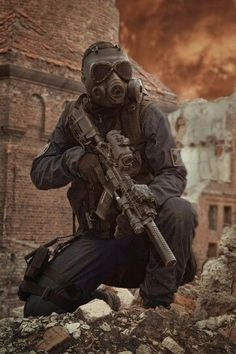 Nuclear post apocalypse survivor by zabelin on PhotoDune. Sole survivor in tatters and gas mask on the ruins of the destroyed city Military Police, Military Weapons, Military Art, Fallout, Apocalypse Survivor, Zombie Apocalypse Gear, Nuclear Apocalypse, Post Apocalyptic Art, Military Special Forces