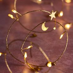 Add a glimmer of gold to your decor with our moon and star micro lights. The 20 warm white LEDs are evenly spread over 2m of flexible wire. | Lights4fun.co.uk