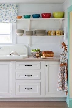 Open Shelving Ideas for the Kitchen - Town & Country Living.love this kitchen.I know you don't see much but it's so charming Cute Kitchen, Vintage Kitchen, Kitchen Ideas, Happy Kitchen, Long Kitchen, Stylish Kitchen, Kitchen White, Wooden Kitchen, Kitchen Redo