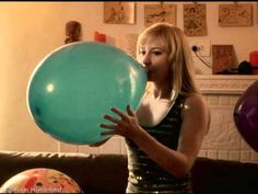 blowing up a balloons | Odette blowing up a blue balloon to pop it. See the full clip at ...