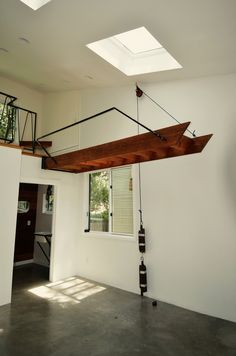 Stairs lift up using a pulley system.                                                                                                                                                     More