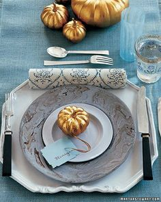 Add glam to table decor by spraying mini pumpkins gold (both ideas from Martha Stewart Weddings).     http://www.loveolio.com/swoon/2010/10/10-fabulous-fall-wedding-ideas/
