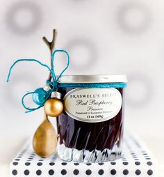 Love the twig spoon wrapped w/ ornaments around the jar... Would be lovely with fresh baked bread as a hostess gift!
