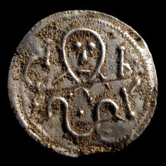 "A coin from King Harald Bluetooth, about 975 to 980"". Photographed just as it…"