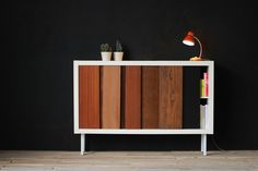 In partnership with the Swedish IKEA, ELLE Belgique asked Hopop Studio to customize the classical Expedit.  DIY EX-PEDIT  Convert your expedit into a vintage slideboard! It's fast and easy, make two grooves in the bottom and high of the structures expedit, find some wooden boards, cut it at the right height and slide them!  Have fun!