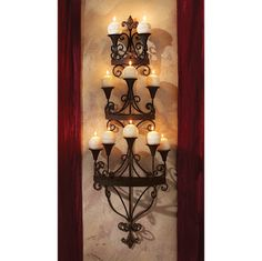 Carbonne Candle Chandelier Wall Sconce, would look good at the end of the hallway for light when the power goes out during storm season.