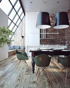 Brick wall, large plank wood floors and big windows