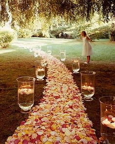 I love how the candles are floating in the water. This would look so pretty if you are having an evening wedding. I am not as much of a fan of all of the flowers though. Just the candles. They have different levels of water too.