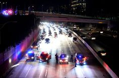 California Highway Patrol officer stop the flow of traffic on the 110 freeway as protesters attempted to rush the freeway, but were unsuccessful, during a march and rally against the election of Republican Donald Trump as President of the United States in Los Angeles, California, U.S. November 11, 2016. (REUTERS/Kevork Djansezian)