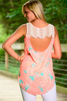 Well, hello gorgeous! This neon coral top is the cutest thing we have seen! The amazing hilo style and the trendy cutout in the back! The bold print makes this one of our favorites!