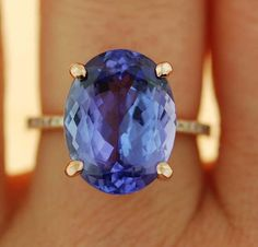 Rose Gold Engagement Ring Lavender Blue Tanzanite cushion cut engagement ring rose gold ring by Eidelprecious. Tanzanite Engagement Ring, Tanzanite Ring, Rose Gold Engagement Ring, Oval Engagement, Thin Diamond Band, Jewelry Stores Near Me, Gold Jewelry, Jewellery, Jewelry Rings