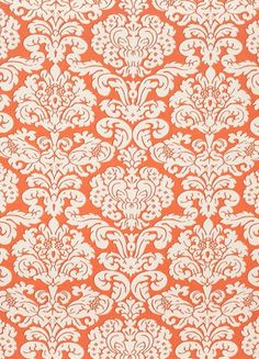 Trelawny Damask Fabric A bold printed fabric with contemporary damask motif, shown in coral on a cream ground.