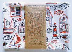 Boats & Beach Huts screen-printed tea towel (cream)