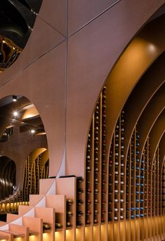 Architectural elements based on wine bottles form a contemporary vaulted ceiling in this wine shop in Valladolid, northwest Spain by Zooco Estudio. Architecture Details, Interior Architecture, Interior And Exterior, Whisky Shop, Feature Wall Design, Wine House, Wine Display, Pop Up Shops, Commercial Design