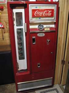 The bicycle shop used to have this kind of Coke machine. Loved that rubber smell, and the frostiness of a bottle of Coke on a hot day.