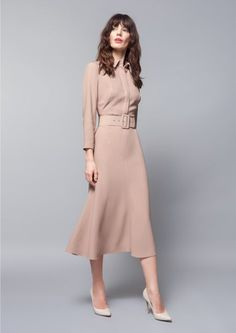 Nude simplicity In a Matte silk blouse fitted close to the body and a mid calf a line skirt with a large belt in the same material accentuating the waist. By Alexander Terekhov.