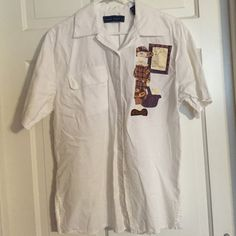 Just In!  Karen Scott Quilt Shirt. Size XL Karen Scott white short sleeve blouse with quilter on front with rules of the guild. Quilt, quilts and more quilting.  Excellent condition. Karen Scott Tops Blouses