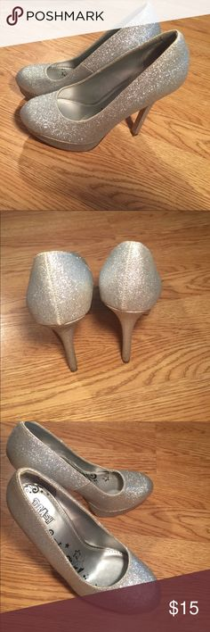 Brash Silver Glitter platform stilettos Beautiful 5.5 in platform heel only issue is what appears to be maybe glue from manufacturer pictured on front of shoe lightly worn a couple of times any questions please ask! Brash Shoes Heels