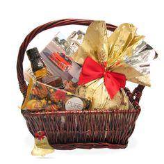 Aventura este un cadou deosebit, ce contine specialitati dulci, precum panettone si trufe de ciocolata cu caramel, acompaniate de un whisky ...