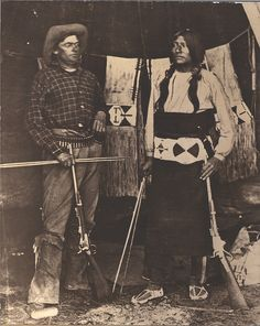 Two men with rifles, one Shoshone