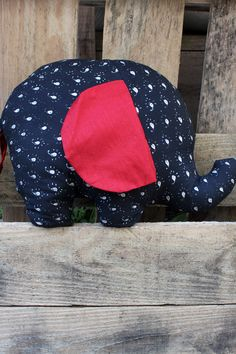 This black and red elephant pillow is great for indoor and outdoor chairs and seats. The proceeds of this product help survivors of human trafficking, forced lasbor, and crime have a safe place to go,