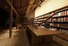 Cotia Library Garden | IPEA—Cota, Brazil. A shelf angled within a set of shelves.