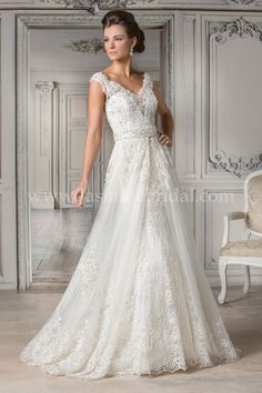 Jasmine Bridal Couture Style T172063 in Ivory // Feel like a regal bride in this princess wedding dress with Alençon and Chantilly Lace. An A-line tulle skirt and detachable train add versatility while a portrait neckline lays a beautiful décolletage. Optional style T172063U (gown only without detachable train)
