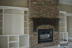 Stoned Fireplace Ceiling high with Mantle and hearth and built in shelves. Fawn River and Copperton Laytite J&N Stone
