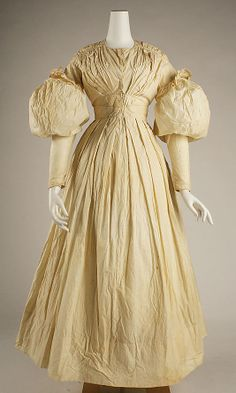 1828 Morning Dress, American Cream colored, long sleeves, puff above elbows, high-waisted, full skirt. metmuseum.org