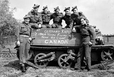 "Infantrymen of ""D"" Company The Seaforth Highlanders of Canada with their Universal Carrier on which is inscribed ""Germany Kaput - Italia Tutto Finito - Here We Come - Canada"". May 5 Canadian Soldiers, Canadian Army, Canadian History, American Soldiers, Ww2 Pictures, Historical Pictures, Military Photos, Military History, D Company"